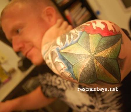 Paintful Star Tattoo Design on Elbow