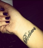 Believe Tattoos on Woman's Wrist