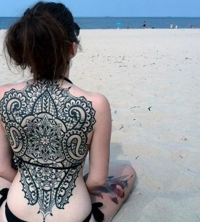 lace and tribal back tattoo
