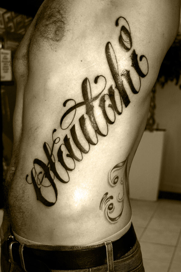 Large Lettering Tattoo For Men