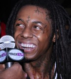 Lil Wayne Tattoos in her TV Show Interview