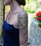 Half Sleeve Lion Tattoo Design for Woman
