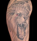 Blood-teared Lion with Crown Tattoo Designs for Women