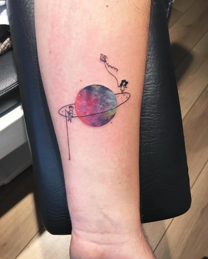 little-boy-and-little-girl-cirlce-tattoo