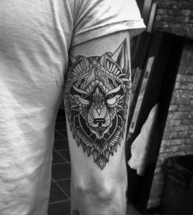 lone wolf tribal tattoo