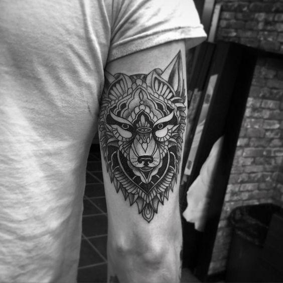 lone wolf tribal tattoo