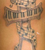 Music Notes Tattoos On Rib