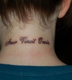 Back Of Neck Love Conquers Tattoo