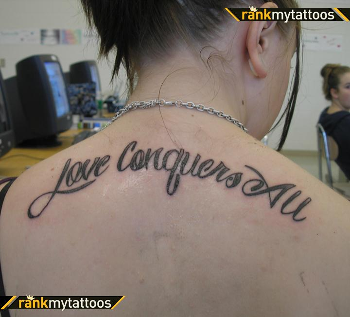 Upper Back Love Conquers Tattoo