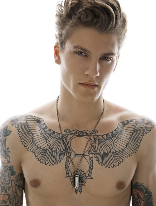 Chest Plate With Wing Tattoo On Chest