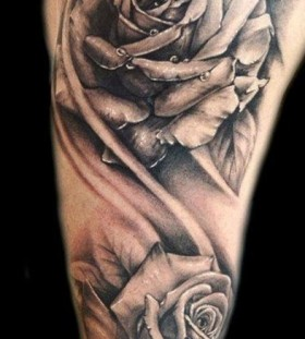 man rose sleeve flower tattoo