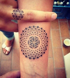mandala finger and arm tattoo