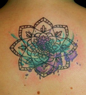 mandala style watercolor flower tattoo