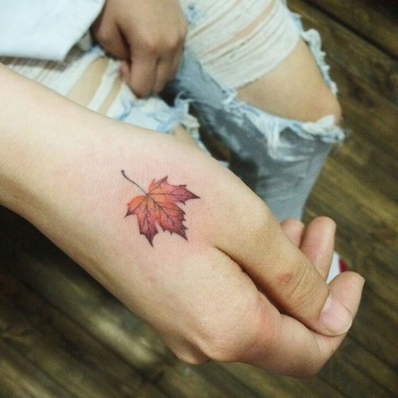 maple-leaf-on-hand-autumn-tattoo