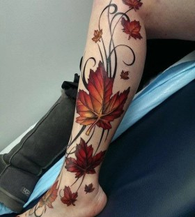 maple-leaves-on-leg-autumn-tattoo