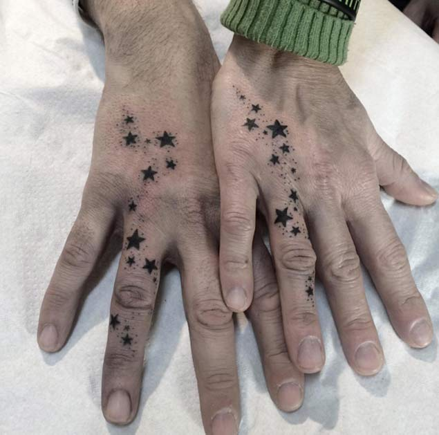 matching stars couple tattoo