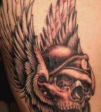 Awesome Tattoo Design of Skull and Eagle's Wings - Skull Tattoos