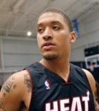 Michael Beasley - Upper Arm And Shoulder Tattoo