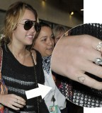 Miley Cyrus Got Another Heart Tattoo in hand