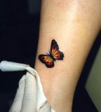 Cute Orange-Winged Monarch Butterfly Leg Tattoos - Butterfly Tattoos