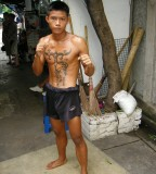 Cool Picture of Muay Thai Fighter Tattoo on Chest