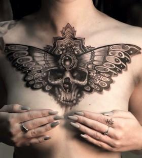 mumia916-wing-skull-tattoo