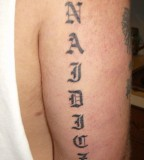 Last Name Arm Tattoo Design