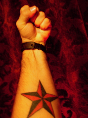 Black and Red Nautical Star Forearm Tattoo Design Pic