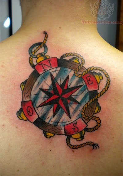 Nautical Star Compass Tattoo On Back Body For Men