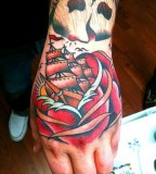 Flower Ship and Old School Skull Tattoo on Hand