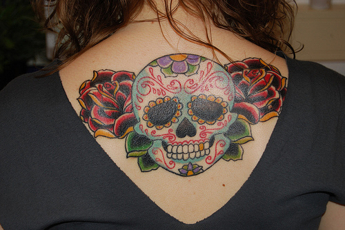 Ethnic Style Old School Skull Tattoo Design On Upper Back