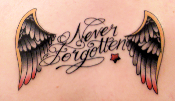 """Beautiful Letters / Quote """"Never Forgoten"""" over-shoulder Tattoos"""