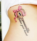 Upper Abdomen Heart Lock with Pinky Ribbon Tattoo