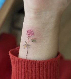 pink rose wrist flower tattoo