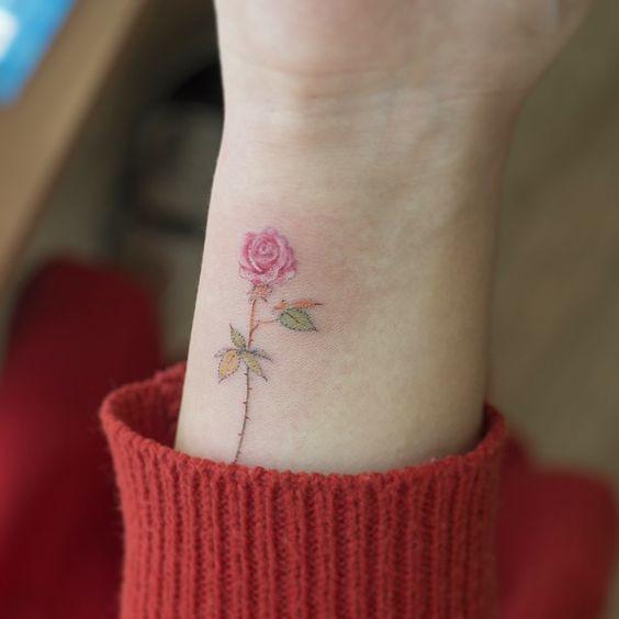 pink rose wrist flower tattoo
