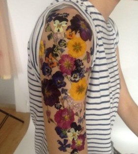 pressed flower effect arm flower tattoo