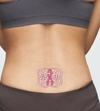 Purple Ribbon Tattoo On Hip For Girl