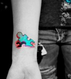Bright Colored Peeling Puzzle Piece Tattoo on Wrist