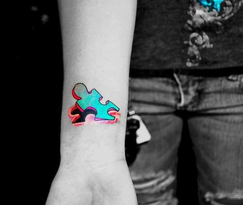 Bright Colored Peeling Puzzle Piece Tattoo on Wrist