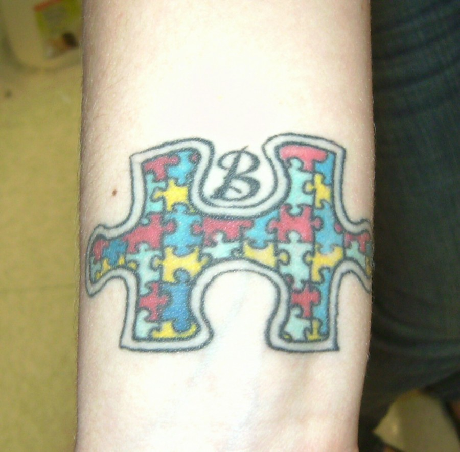 Colorful Puzzle Piece with B Initial Forearm Tattoo