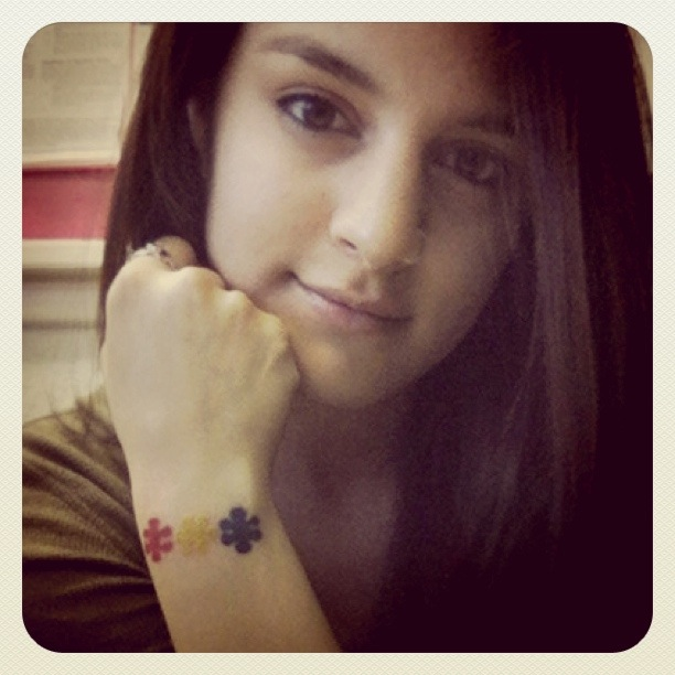 Three Little Different Color Puzzle Pieces Outer Wrist Tattoo Idea for Girls