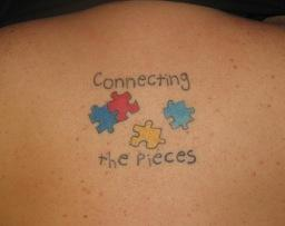 Funny Puzzle Pieces Back Tattoo