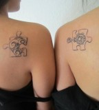 Couple Puzzle Piece Tattoos Meaning on Two Girls Back Shoulder