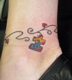 Puzzle Piece Hanging on Swirly Ornament Ankle Tattoo