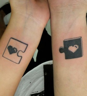 puzzle with heart couples tattoos