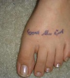 Groovy Tattoo Design With Words On Foot