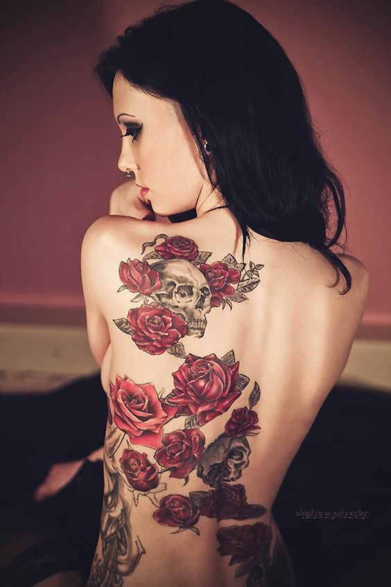 red rose and skull flower tattoo on back