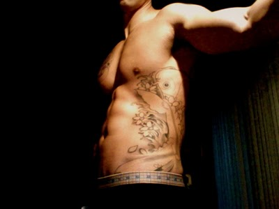 Muscular Men with Rib Tattoo Ideas