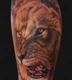 Symbol of Strength Roaring Lion Tattoo
