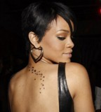 Rihanna's Ink Dictionary Tattoo On Her Back